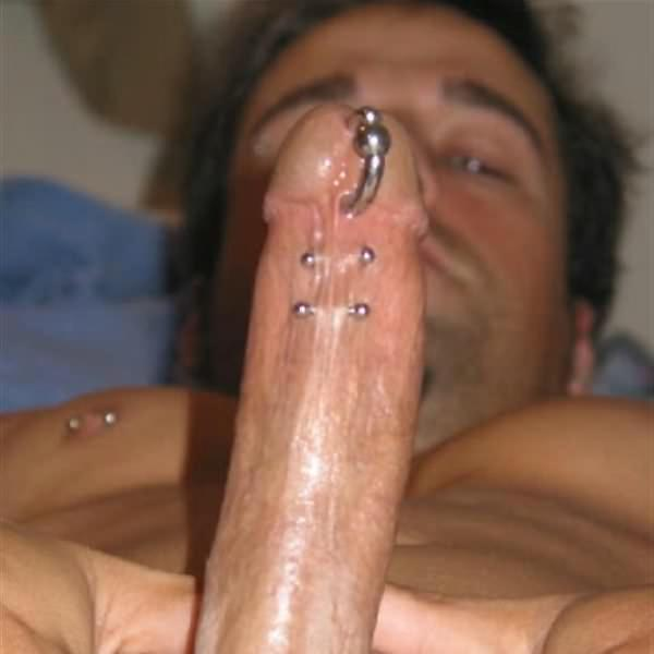 Inked and pierced jock has huge cock
